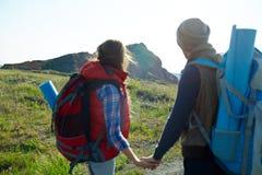 Tourists Walking to Mountain Stock Photography