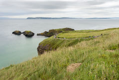 Tourists Walking to the Rope Bridge - Northern Ireland Royalty Free Stock Images