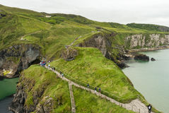 Tourists Walking to the Rope Bridge - Northern Ireland Royalty Free Stock Photography