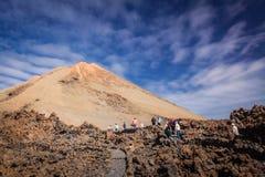 Tourists walking towards Pico del Teide volcano royalty free stock photo