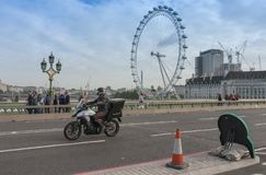 Tourists walking and traffic on Westminster bridge Stock Images
