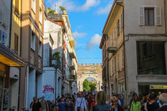 Tourists walking from Tre Martiri square in Rimini, Italy. Rimini, Italy - August 16, 2014: Tourists walking from Tre Martiri square (Piazza Tre Martiri) to Arch Royalty Free Stock Image