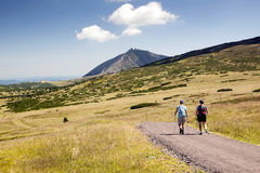 Tourists walking on trip, Czech mountains Royalty Free Stock Photo
