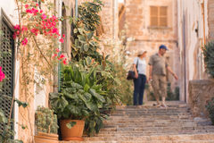 Tourists walking on typical mediterranean street in small town Stock Photography