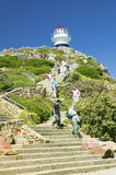 Tourists walking up steps leading to old Cape Point Lighthouse at Cape Point outside of Cape Town, South Africa Stock Photo