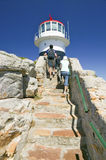 Tourists walking up steps leading to old Cape Point Lighthouse at Cape Point outside of Cape Town, South Africa Royalty Free Stock Photo