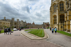 Tourists walking through Windsor Castle grounds Stock Images