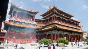 Tourists walking about Yonghegong Lama Temple Royalty Free Stock Image