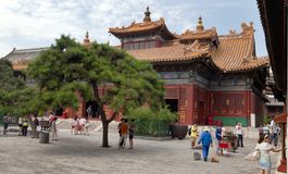 Tourists walking about Yonghegong Lama Temple Stock Images