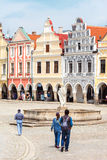 Tourists walks around main marget in Telc, Czech Republic. TELC, CZECH REPUBLIC - MAY 10, 2013: Tourists walks around main marget in Telc city – Unesco Royalty Free Stock Photo