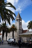 Tourists walks on sea promenade of old town Trogir Royalty Free Stock Photos