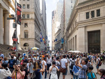 Tourists at Wall Street near the Federal Hall in Manhattan Stock Photo
