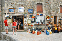 Tourists walting and shopping at a ceramic shop in Pals Royalty Free Stock Image