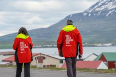 Tourists wandering around the streets of village of Hrisey in Iceland stock image