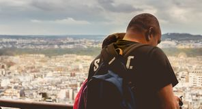 Tourists watch Paris from the top of the Eiffel Tower. Paris, France - October 08, 2017 : tourists watch Paris from the top of the Eiffel Tower on a fall day Stock Photography