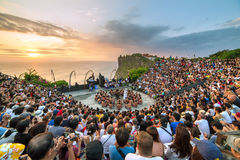 Tourists watch traditional Balinese Kecak Dance at Uluwatu Temple Royalty Free Stock Images