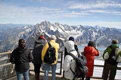 Tourists watching the Alps royalty free stock photo