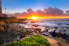Tourists watching the beautifal sunset at La Jolla stock image