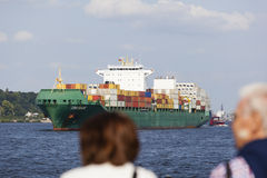 Tourists watching container ship, editorial Royalty Free Stock Images