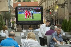 Tourists watching football game Royalty Free Stock Image