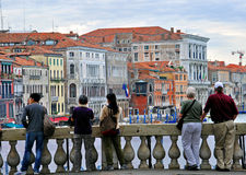 Tourists watching on Grand Canal from Rialto bridge Stock Photo