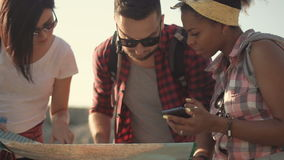 Tourists watching map while traveling stock footage