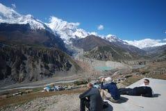 Tourists watching Nepali landscape royalty free stock images