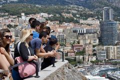 Tourists watching from the Prince's Palacer Royalty Free Stock Image