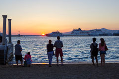 Tourists watching the sunset in Mykonos Stock Photo