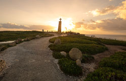 Tourists watching the sunset near the cross monument at Cabo da Stock Image