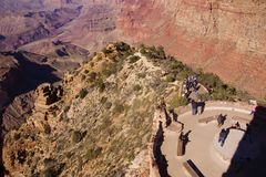 Tourists on the Watchtower platform gaze at the canyon Stock Photography