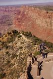 Tourists on the Watchtower platform gaze at the canyon. GRAND CANYON, ARIZONA - SEP 28, 2013 - Tourists on the Watchtower platform gaze at the canyon  just Royalty Free Stock Photography