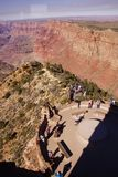 Tourists on the Watchtower platform gaze at the canyon. GRAND CANYON, ARIZONA - SEP 28, 2013 - Tourists on the Watchtower platform gaze at the canyon  just Stock Images