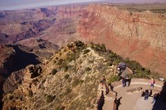 Tourists on the Watchtower platform gaze at the canyon Royalty Free Stock Photos