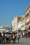 Tourists on the water front Riva degli Schiavoni in Venice - Ita Royalty Free Stock Images