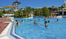 Tourists in a water park. Tourists enjoying water attractions in Adaland Water Park - Kusadasi, Turkey. Adaland Aquapark is one of the biggest water parks in the Stock Photography