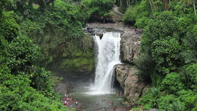 Tourists at a waterfall stock video footage