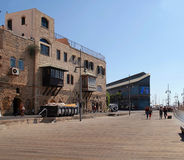 Tourists on the waterfront at the famous Old Port of Jaffa in Te Royalty Free Stock Image