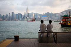 Tourists on the waterfront of Hong Kong Royalty Free Stock Images