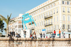 Tourists on the waterfront. People vacationing in Nice on the Cote d`Azur royalty free stock photography
