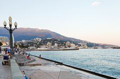 Tourists on waterfront in Yalta city in evening Stock Image