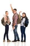 Tourists waving goodbye. Group of cheerful young tourists waving goodbye isolated on white royalty free stock photo