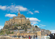 Tourists on the way to the abbey of Mont Saint Michel. Normandy, France royalty free stock photos