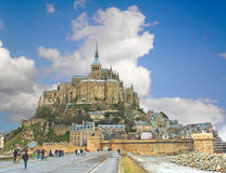 Tourists on the way to the abbey of Mont Saint Michel. Royalty Free Stock Photo