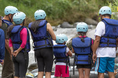 Tourists wearing helmet preparing for river tubing in Ecuador Royalty Free Stock Photography