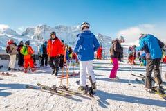 The tourists wearing ski suit are fun to play ski on gornergrat , Zermatt mountain , switzerland. This picture is taken 14 Feb 2. The tourists wearing ski suit Royalty Free Stock Photography