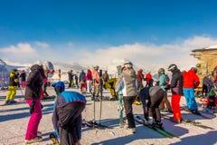 The tourists wearing ski suit are fun to play ski on gornergrat , Zermatt mountain , switzerland. This picture is taken 14 Feb 2. The tourists wearing ski suit Royalty Free Stock Image