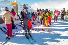 The tourists wearing ski suit are fun to play ski on gornergrat , Zermatt mountain , switzerland. This picture is taken 14 Feb 2. The tourists wearing ski suit Royalty Free Stock Photos