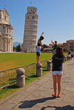 Tourists were mimicking the action of pushing Leaning Tower of Pisa Staight. Everyday thousands of Tourists were mimicking the action of pushing Leaning Tower of Royalty Free Stock Photography