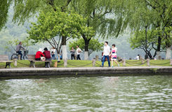 Tourists by the West Lake in Hangzhou, China Royalty Free Stock Photo